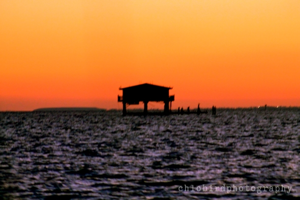 Silhouette of stiltsville house